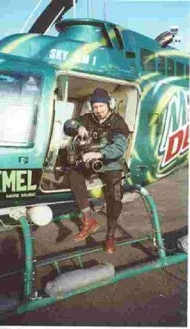 Image of Ian Perry preparing to film from a helicoptor over San Francisco